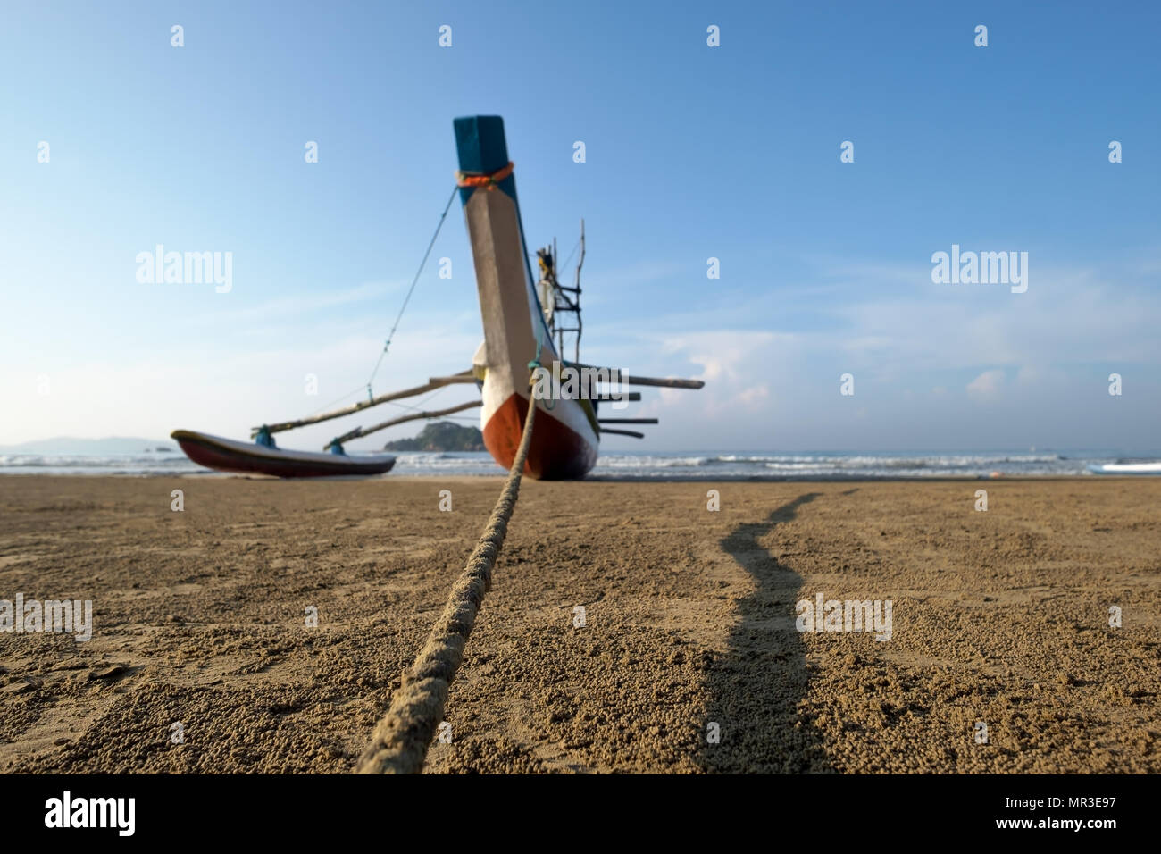 Sri Lankan traditional fishing catamarans. on sandy beach. Stock Photo