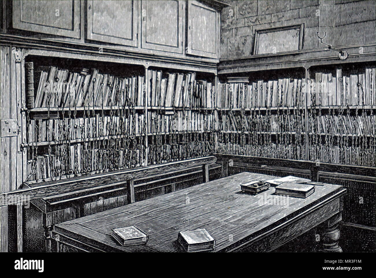 Illustration depicting the chained library of the All Saints Church, Hereford, founded in 1715. A chained library is a library where the books are attached to their bookcase by a chain, which is sufficiently long to allow the books to be taken from their shelves and read, but not removed from the library itself. Dated 19th century - Stock Image