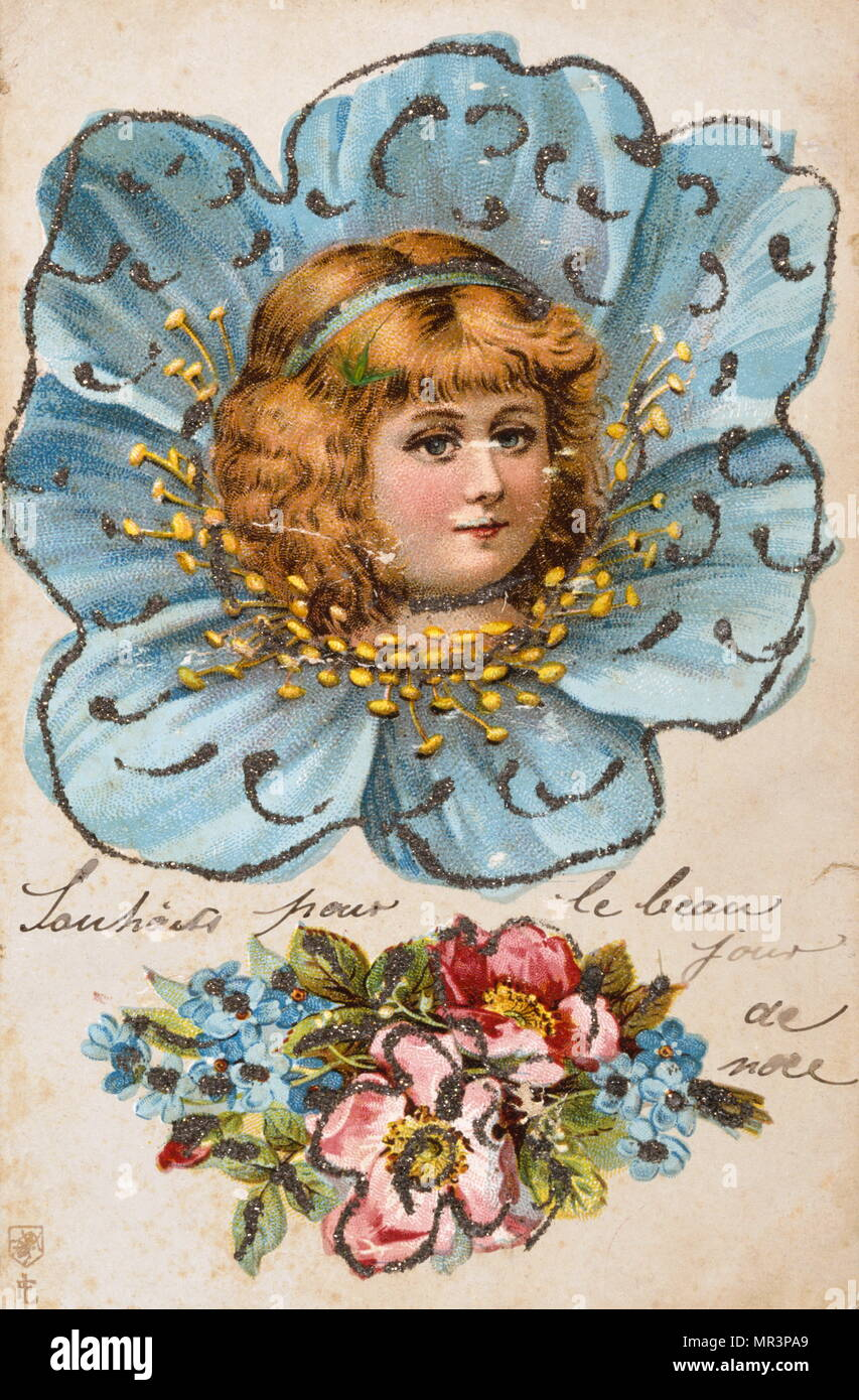 French Happy Christmas, postcard depicting a young angelic child smiling, circa 1900 - Stock Image