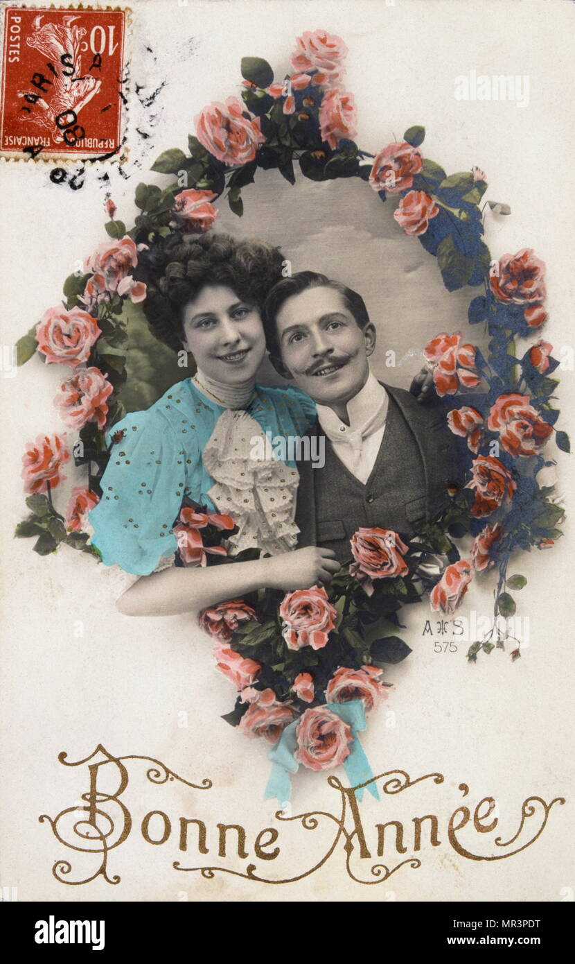 french happy new year postcard depicting a couple surrounded by flowers 1900