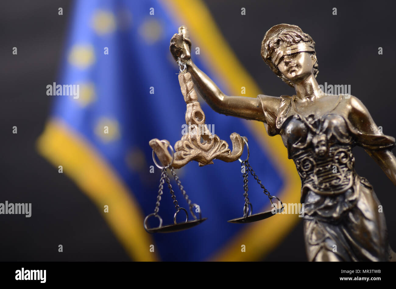 Law and Justice, Legality concept, Scales of Justice, Lady Justice in front of the European Union flag in the background. - Stock Image