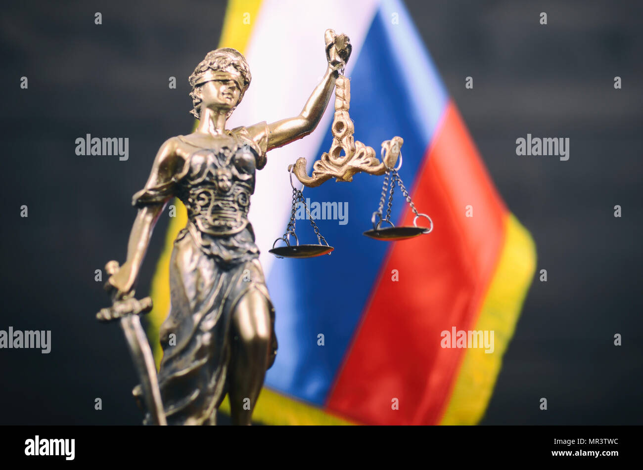 Law and Justice, Legality concept, Scales of Justice, Lady Justice in front of the Russian flag in the background. - Stock Image