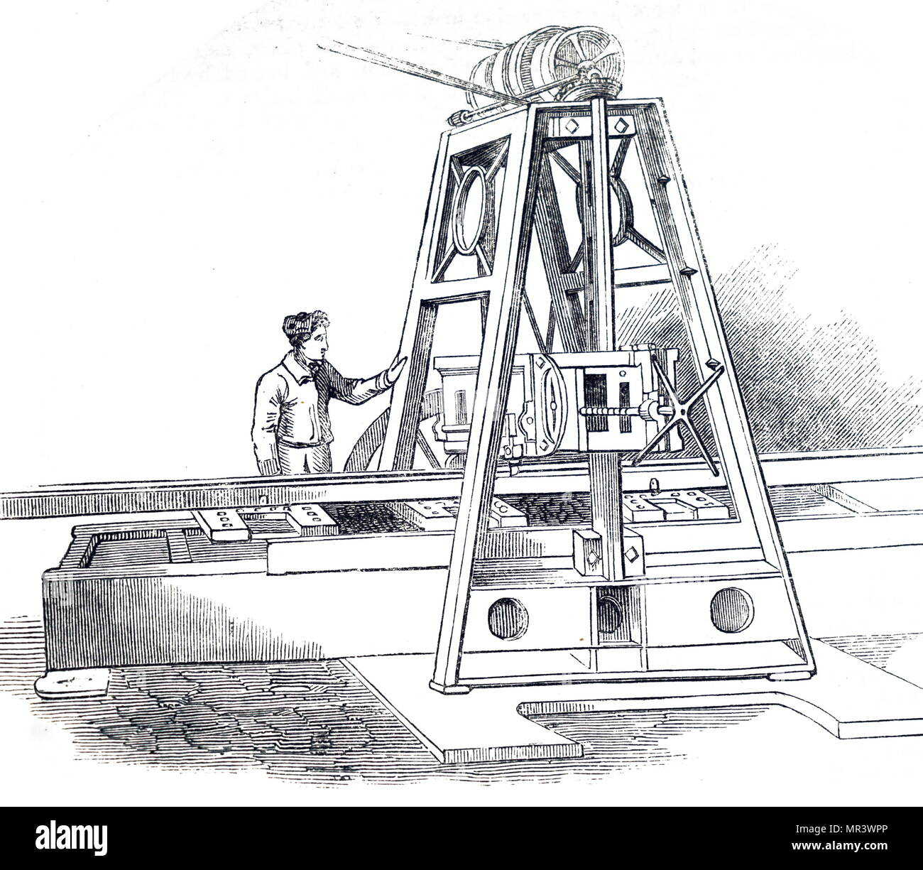 Illustration depicting the planning machine for levelling cast metal surfaces. In place of a plain iron in a box, as in a wood pane, this machine had a piece of hard steel with a keen cutting edge. Dated 19th century - Stock Image