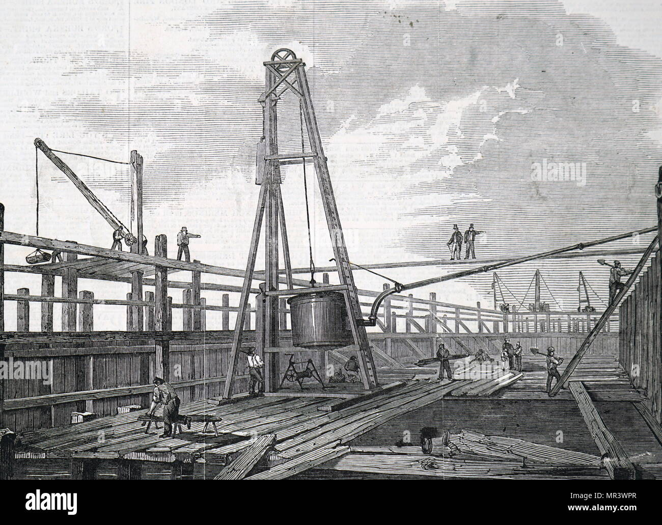 Illustration depicting Clarke & Varley's atmospheric pile driving machine. A steam engine was used to pump out the air from the cylinder, with the result that atmospheric pressure forced a piston downwards. The downward motion of the piston lifted the weight ready for dropping. Dated 19th century - Stock Image