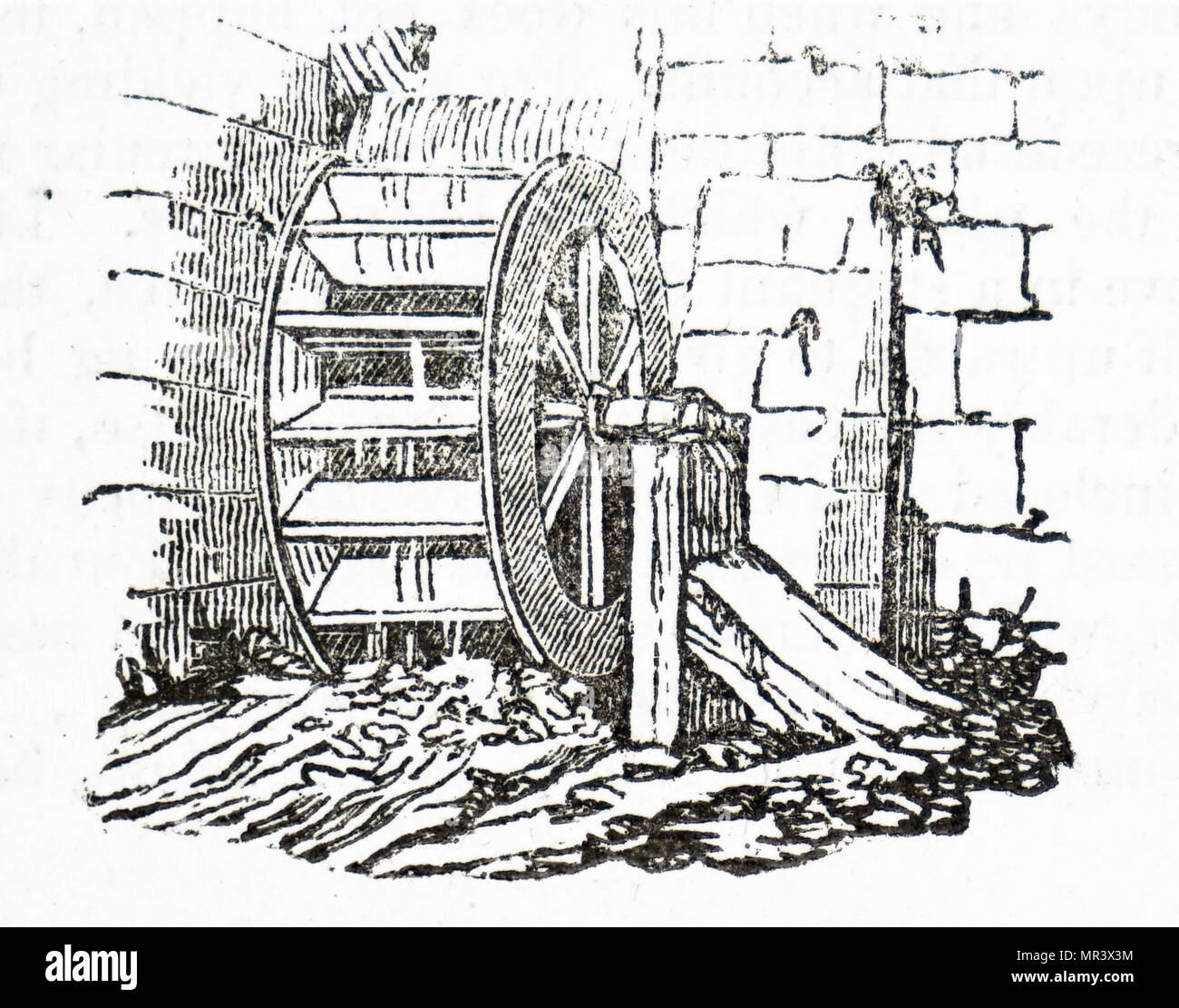 Engraving depicting a water wheel used to drive the machinery at a cotton mill. Dated 19th century Stock Photo