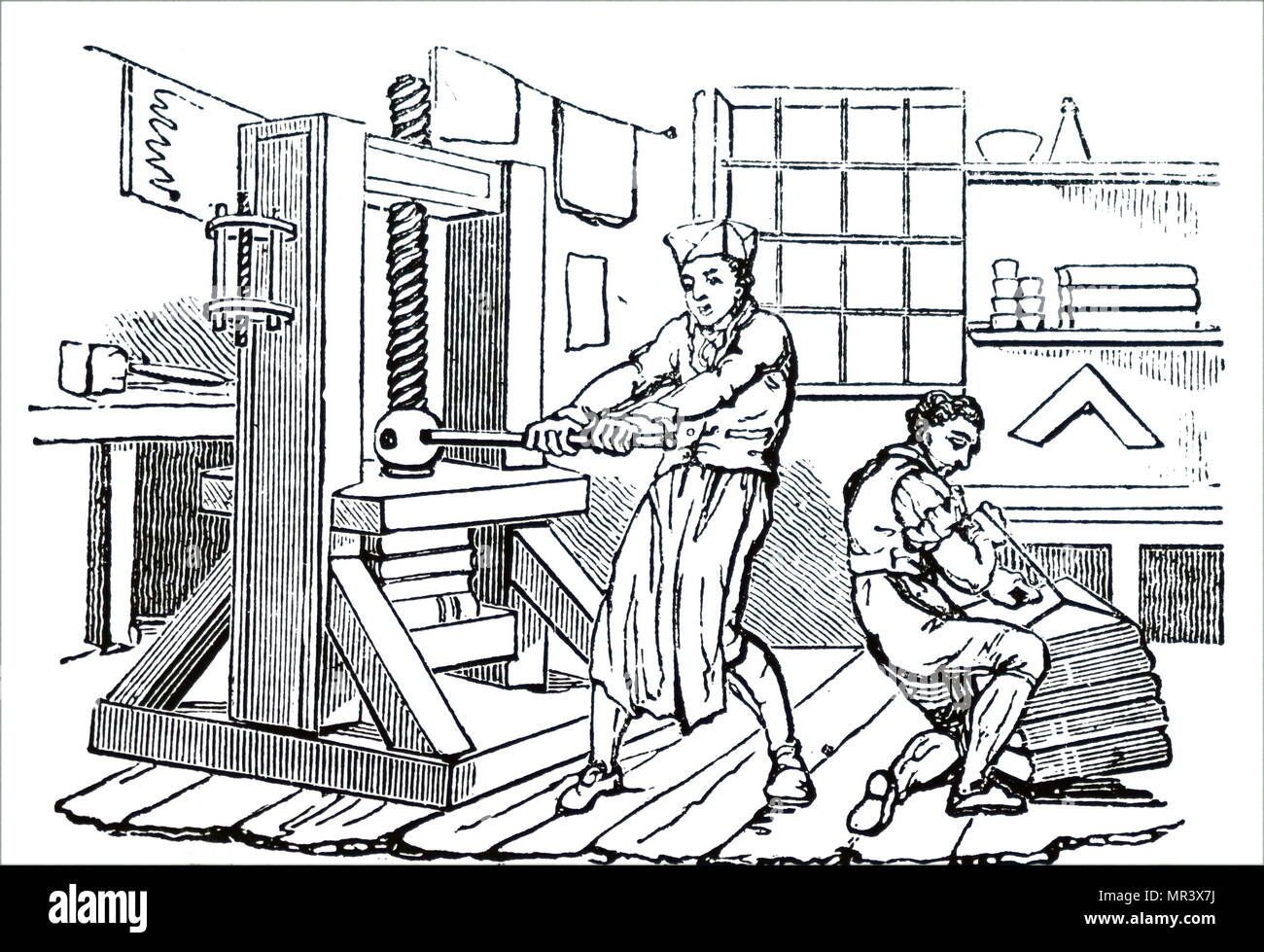 Engraving depicting the compression of printed sheets in a manual press prior to binding. Dated 19th century - Stock Image