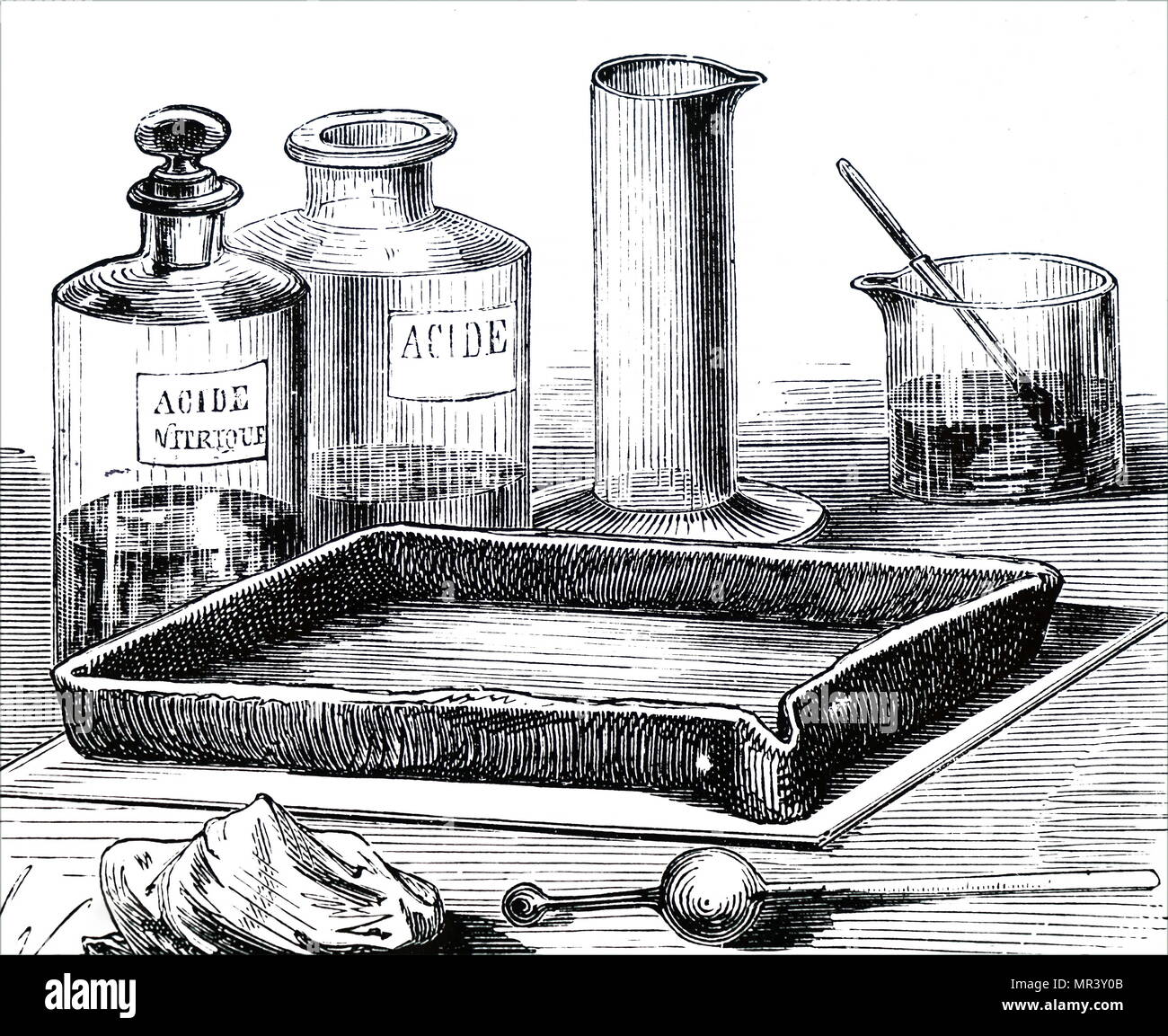Illustration depicting a bath of aqua fortis (concentrated nitric acid) for etching a copperplate. Dated 19th century - Stock Image