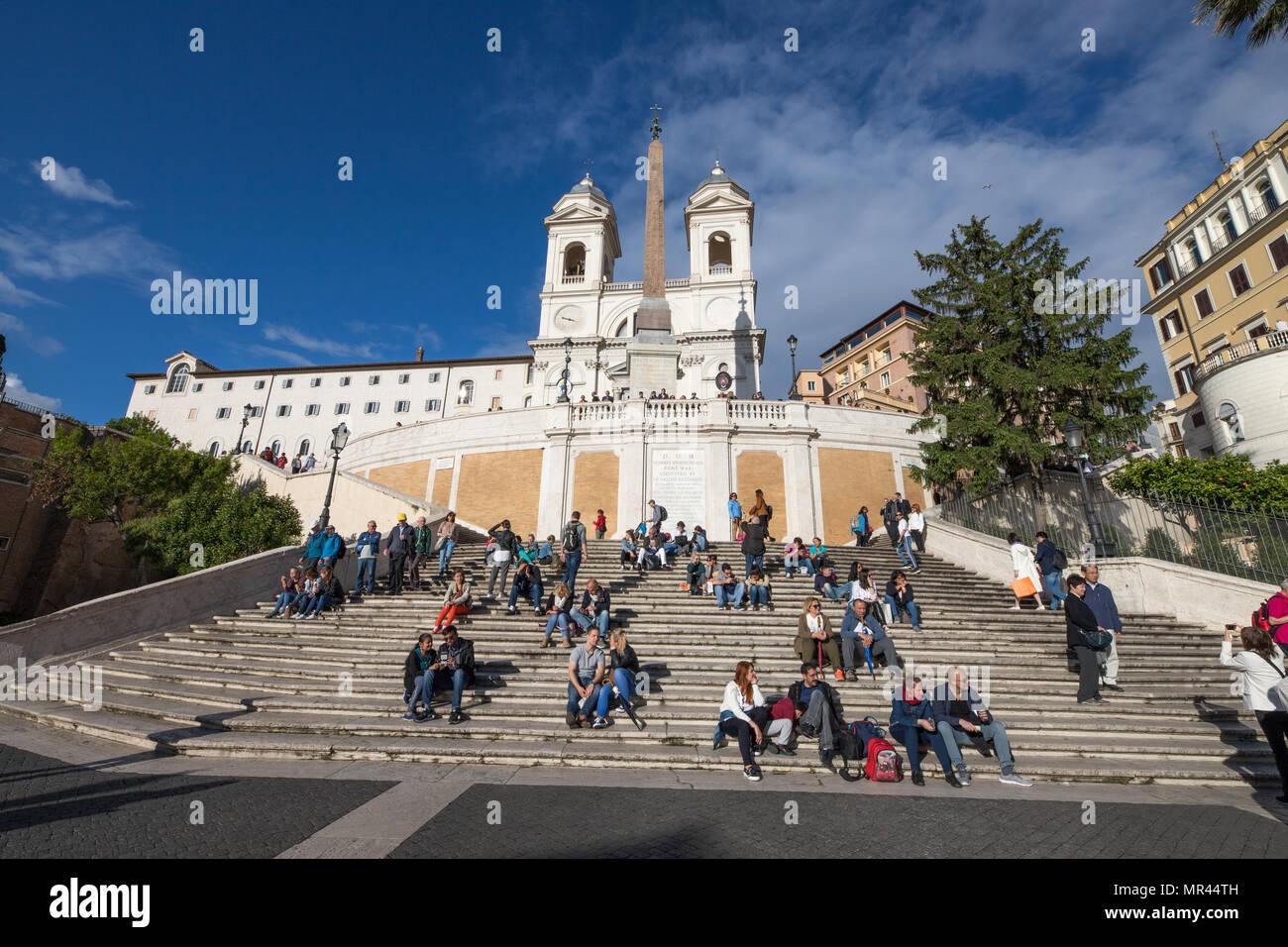 Rome Trinita de Monti, multitude of tourists sitting on Spanish  steps. - Stock Image