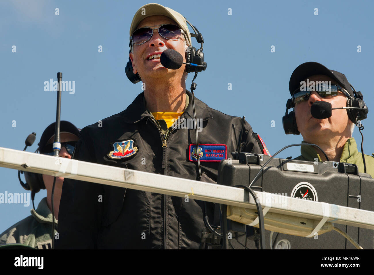 Narrator Rob Reider details each aircraft as they fly over the South Carolina Guard Air & Ground Expo at McEntire Joint National Guard Base, South Carolina, May 6, 2017. This expo is to showcase the abilities of South Carolina National Guard Airmen and Soldiers while saying thank you for the support of fellow South Carolinians and the surrounding community. (U.S. Army National Guard photo by Sgt. Brian Calhoun) - Stock Image