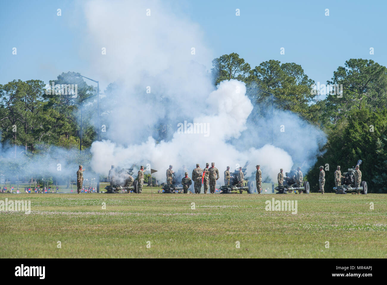 Soldiers of 3rd Infantry Division Artillery conduct a cannon salute during the 3rd Infantry Division change of command ceremony. The 3rd Infantry Division change of command ceremony was held on Cotrell Field at Fort Stewart, GA, May 8, 2017. (U.S. Army Photo by Lt. Col. Brian J. Fickel) - Stock Image