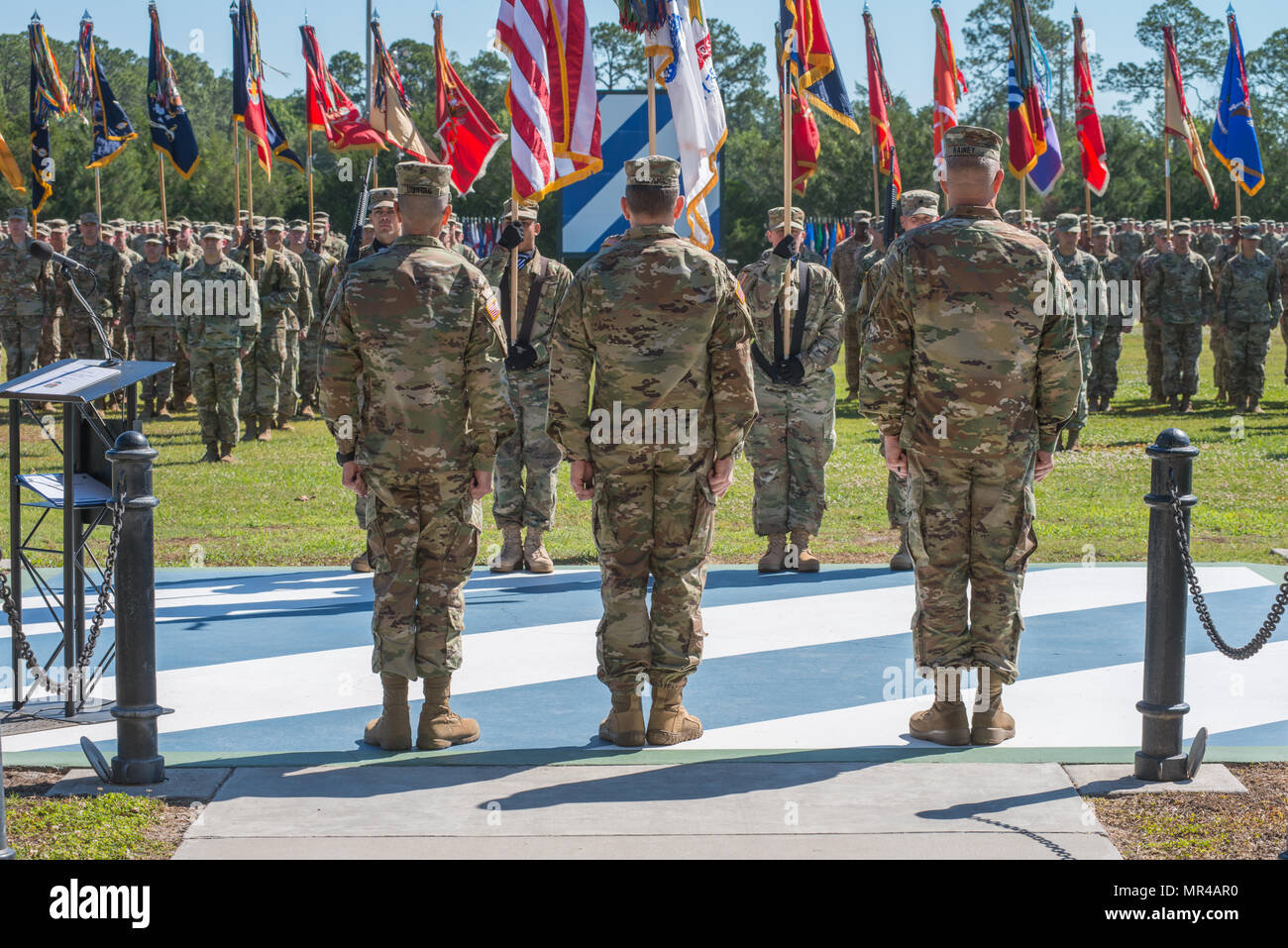 Maj. Gen. Leopoldo Quintas, left, incoming Commander of 3rd Infantry Division, Gen. Robert Abrams, center, Commander U.S. Forces Command, and Maj. Gen. James Rainey, right, outgoing Commanding General 3rd Infantry Division, stand in front of the assembled 3rd Infantry Division. The 3rd Infantry Division change of command ceremony was held on Cotrell Field at Fort Stewart, GA, May 8, 2017. (U.S. Army Photo by Lt. Col. Brian J. Fickel) - Stock Image
