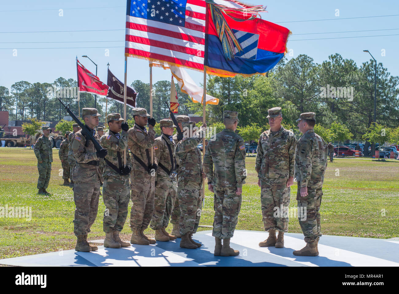 Command Sgt. Maj. Walter Tagalicud, left, 3rd Infantry Division command sergeant major, prepares to pass the division colors to outgoing commander, Maj. Gen. James Rainey. The 3rd Infantry Division change of command ceremony was held on Cotrell Field at Fort Stewart, GA, May 8, 2017. Maj. Gen. Leopoldo Quintas assumed command. (U.S. Army Photo by Lt. Col. Brian J. Fickel) - Stock Image