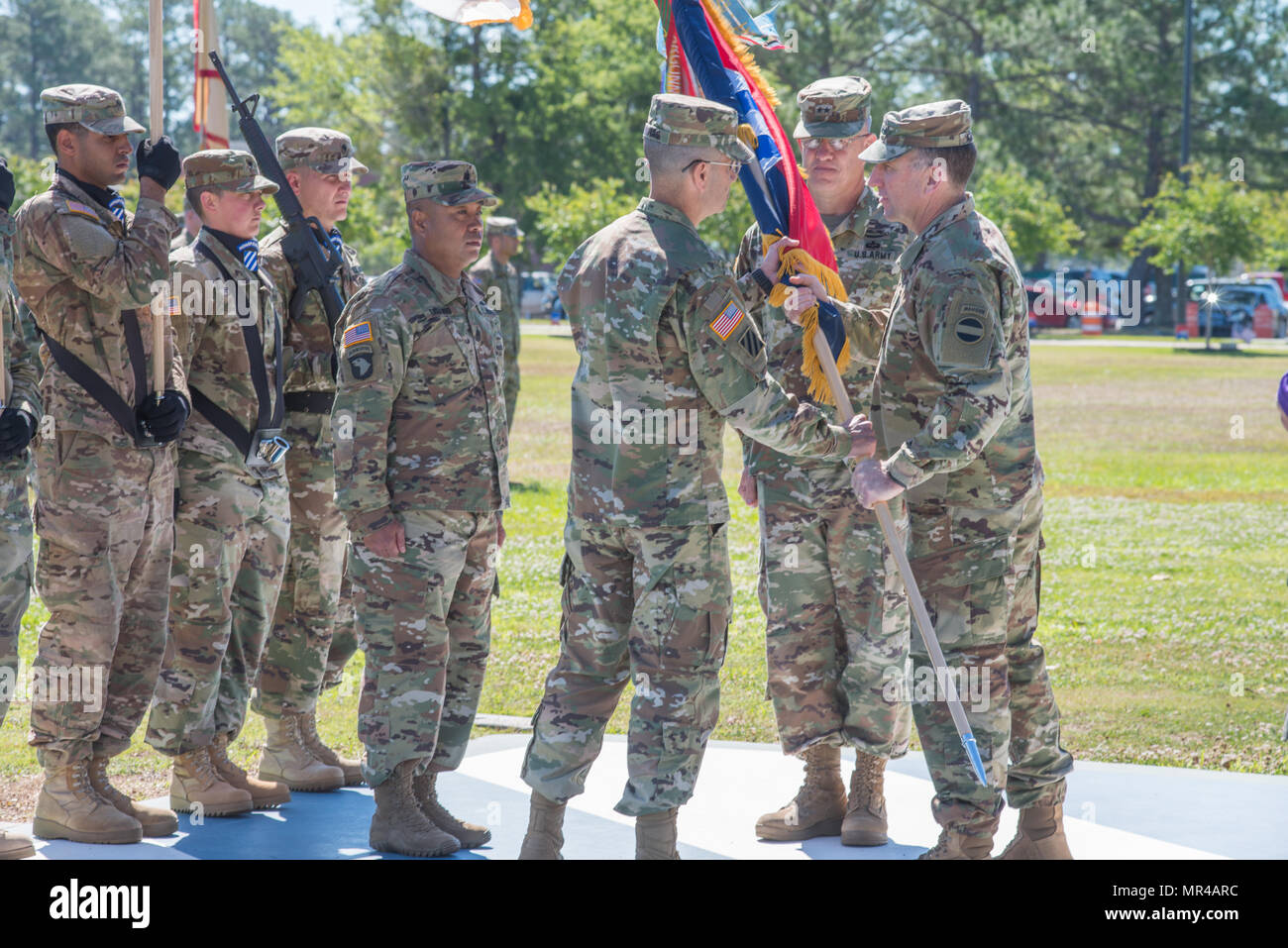 Gen. Robert Abrams, right, Commanding General of U.S. Forces Command, passes the division colors to incoming commander, Maj. Gen. Leopoldo Quintas. The 3rd Infantry Division change of command ceremony was held on Cotrell Field at Fort Stewart, GA, May 8, 2017. Maj. Gen. Leopoldo Quintas assumed command. (U.S. Army Photo by Lt. Col. Brian J. Fickel) - Stock Image