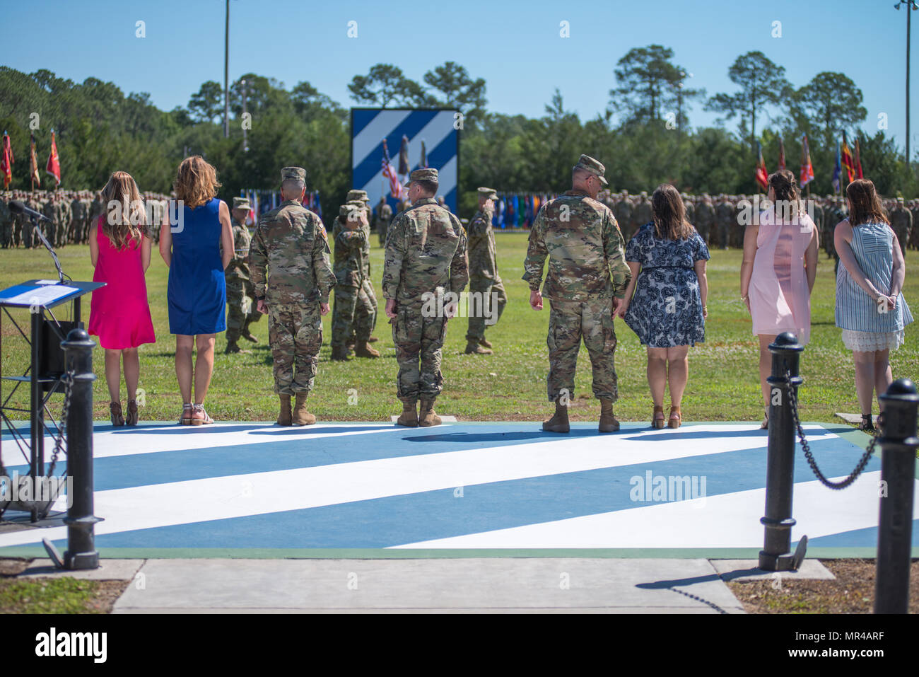 Maj. Gen. Leopoldo Quintas and his family, left, Gen. Robert Abrams and his wife, center, and Maj. Gen. James Rainey and his family, right, participate in the pass and review. The 3rd Infantry Division change of command ceremony was held on Cotrell Field at Fort Stewart, GA, May 8, 2017. (U.S. Army Photo by Lt. Col. Brian J. Fickel) Stock Photo