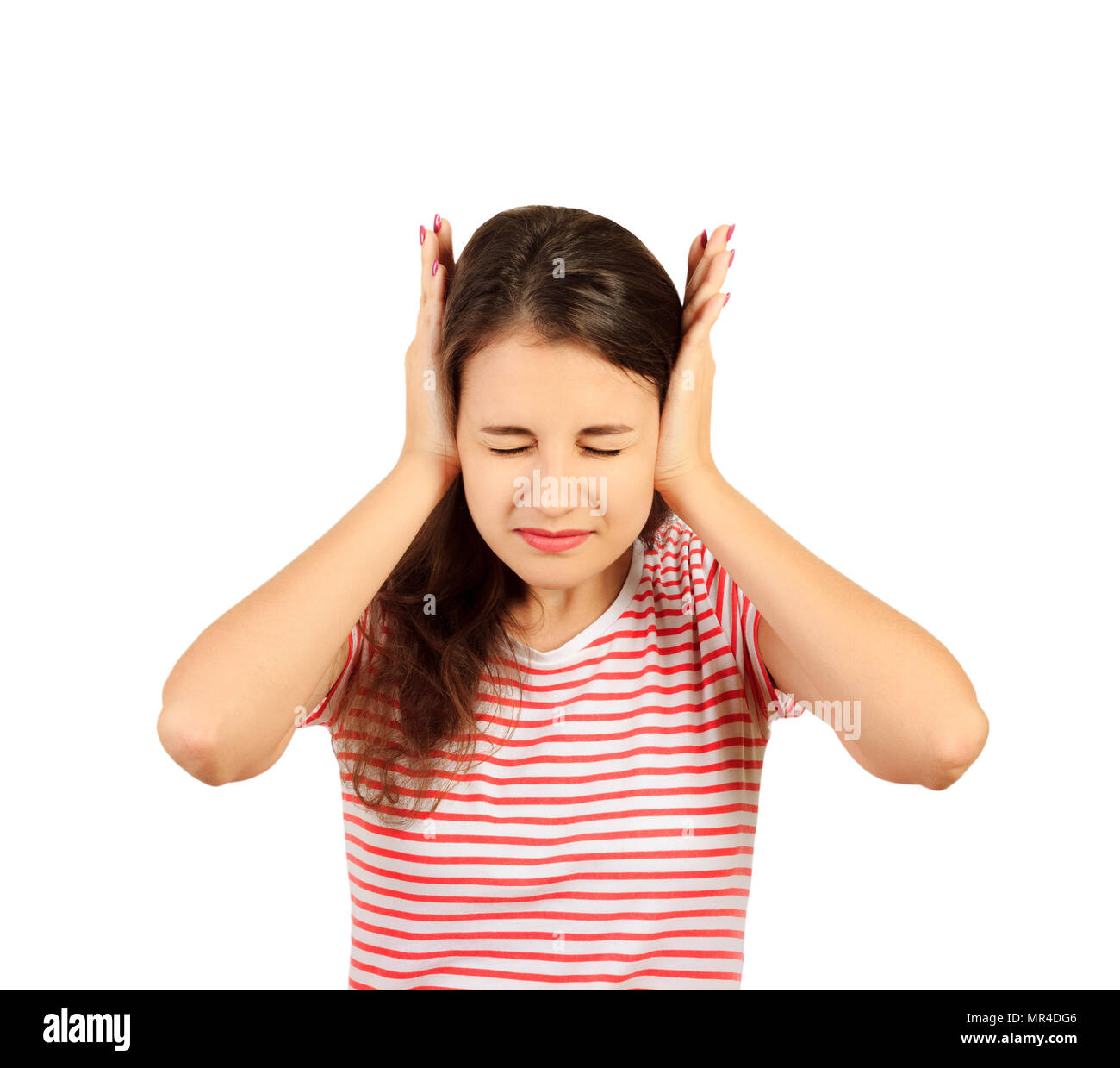an exasperated girl covered her ears with her hands. emotional girl isolated on white background. - Stock Image