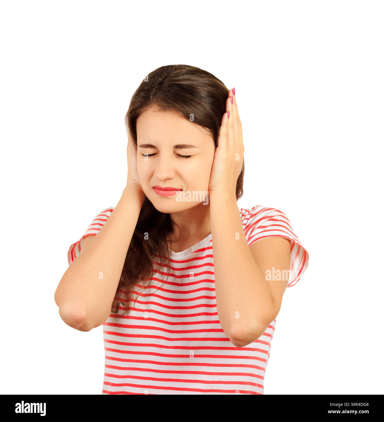 portrait annoyed girl has closed ears hands. emotional girl isolated on white background. - Stock Image