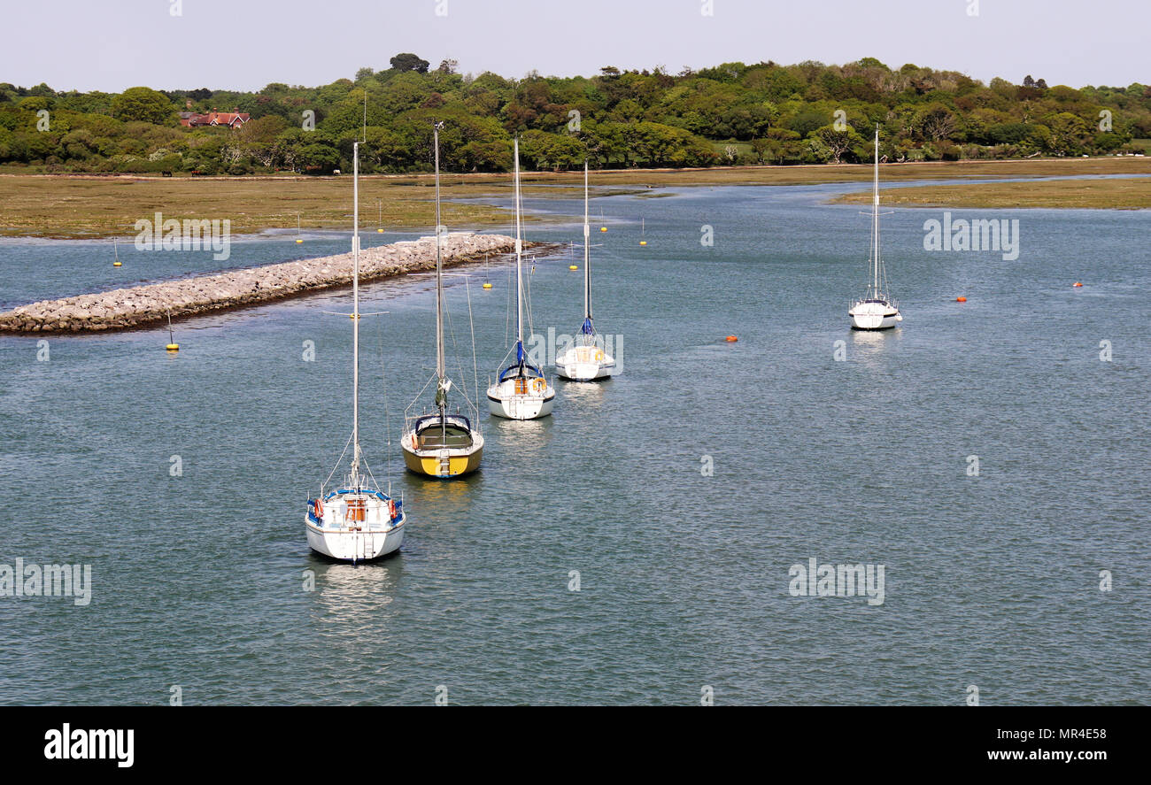 Yachts anchored in the Solent near to Lymington in Hampshire, England Stock Photo