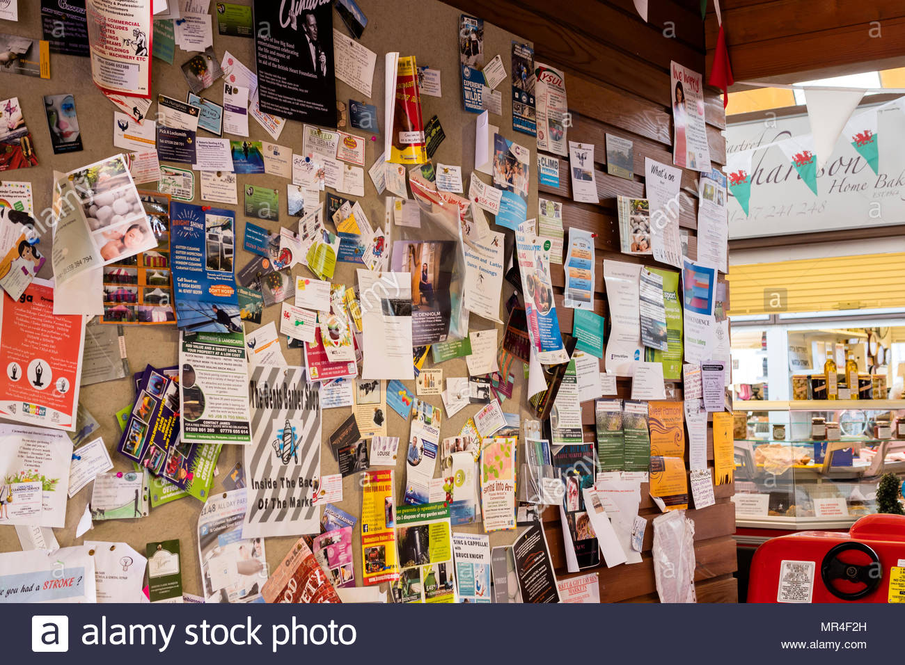 Notice board showing for sale services clubs events - Stock Image