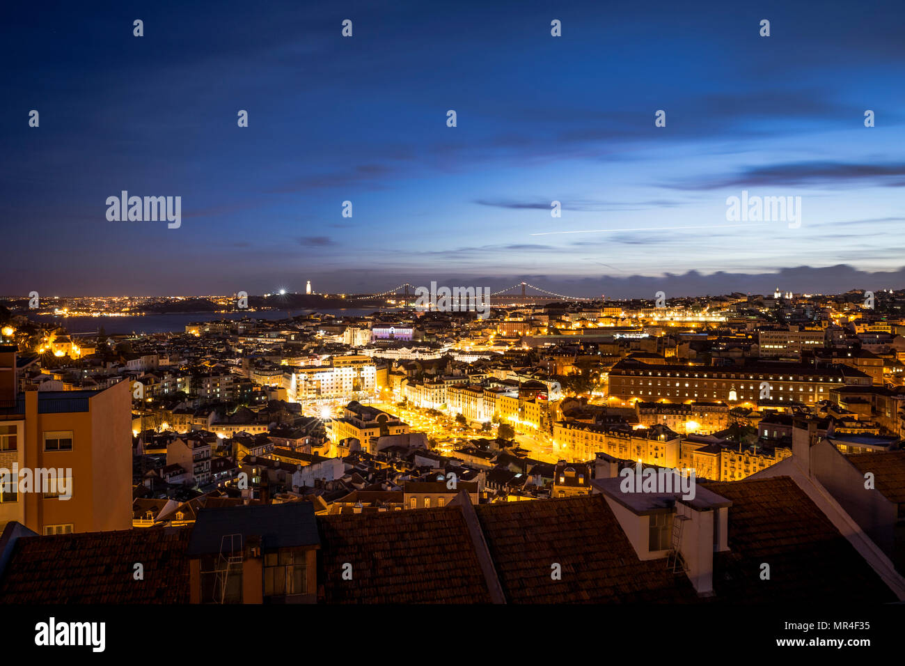 An evening view of the city looking towards the river in Lisbon, Portugal. Stock Photo