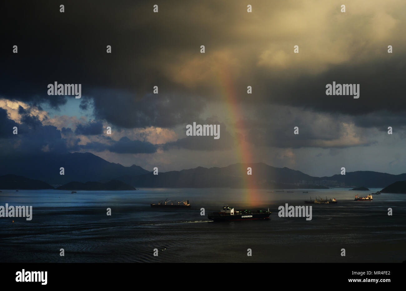 A rainbow over the East Lamma channel in Hong Kong. - Stock Image