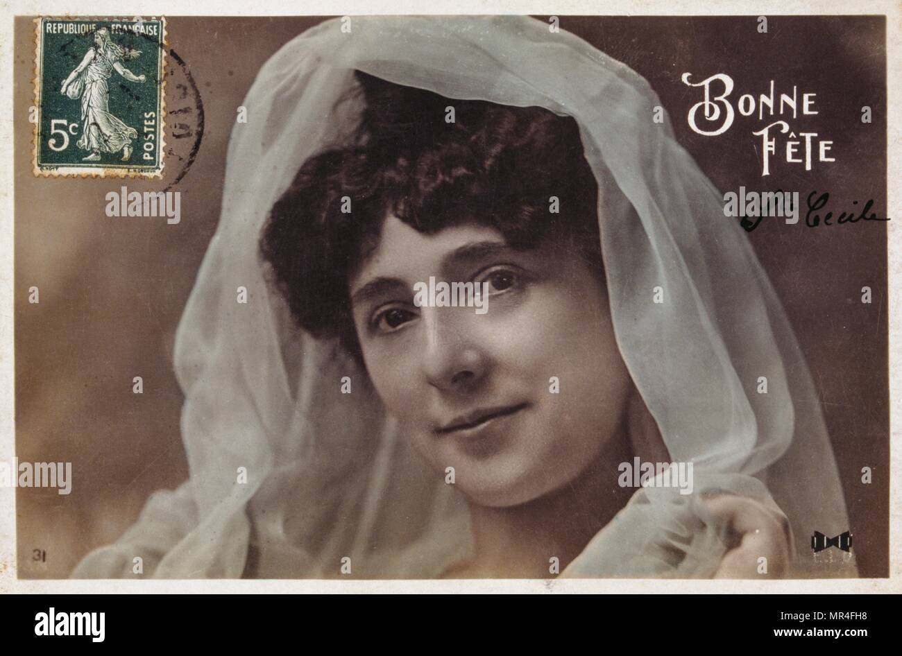 French postcard with an art nouveau image of a woman with a veil 1900 - Stock Image