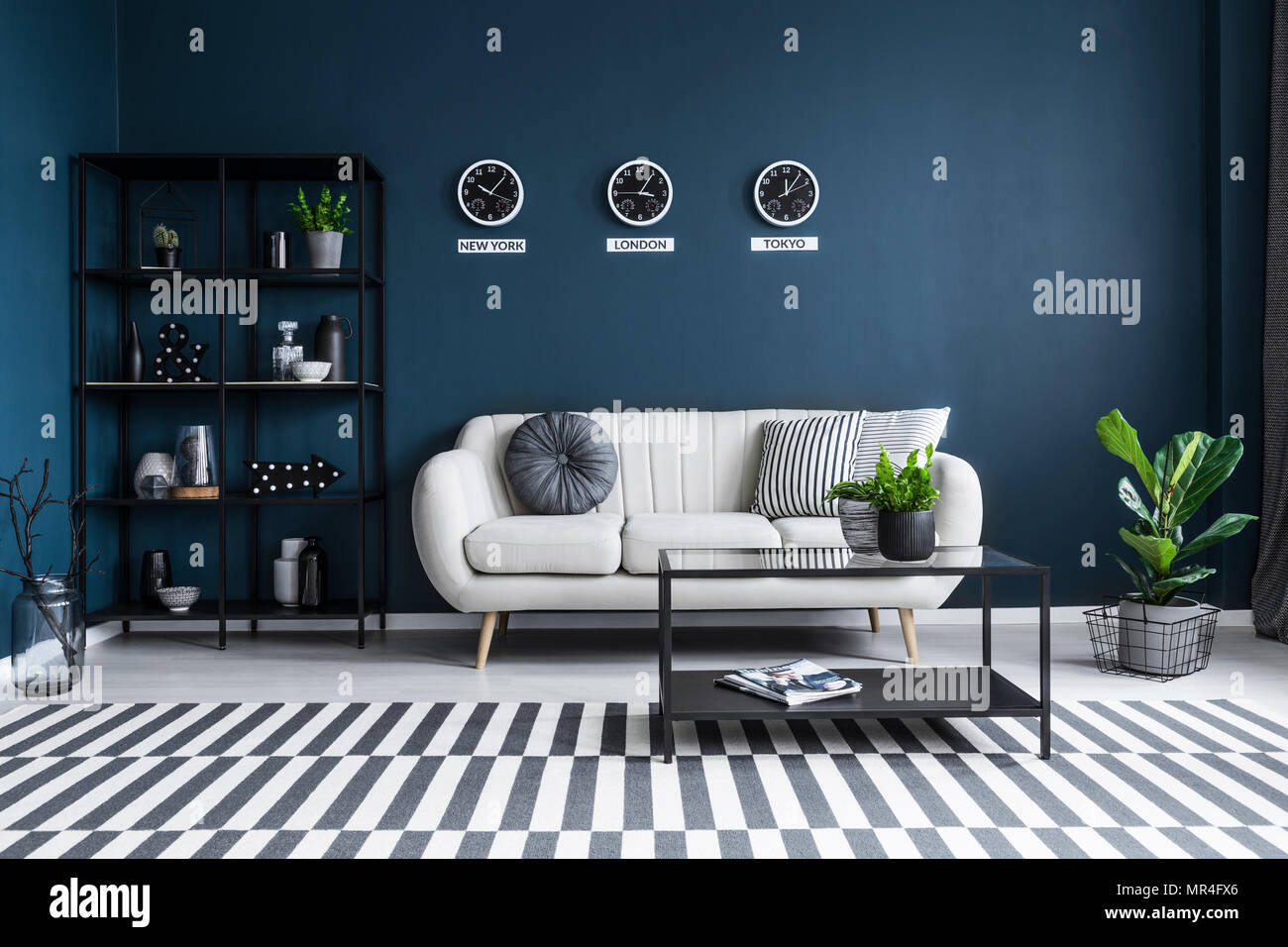 Patterned Carpet In Navy Blue Living Room Interior With Black Table Front Of Beige Couch Stock Photo Alamy