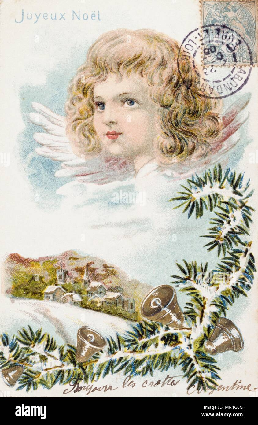French Christmas card showing an angelic child above a snow scene 1900 - Stock Image