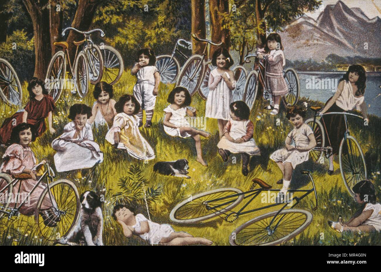 French postcard showing young girls in the countryside with their bicycles 1900 - Stock Image