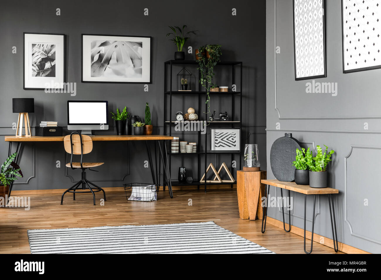 Next office desk Desk Makeover Black Rack With Decorations Standing Next To Wooden Chair And Desk With Plants Lamp And Computer In Home Office Interior Real Photo Black Rack With Decorations Standing Next To Wooden Chair And Desk