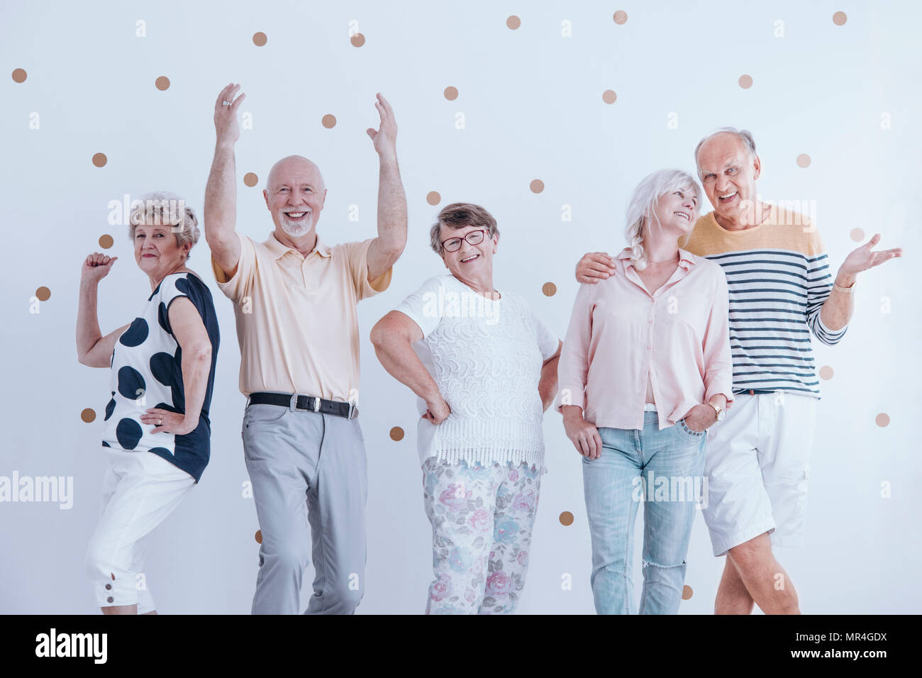 Happy senior people celebrating during birthday party - Stock Image