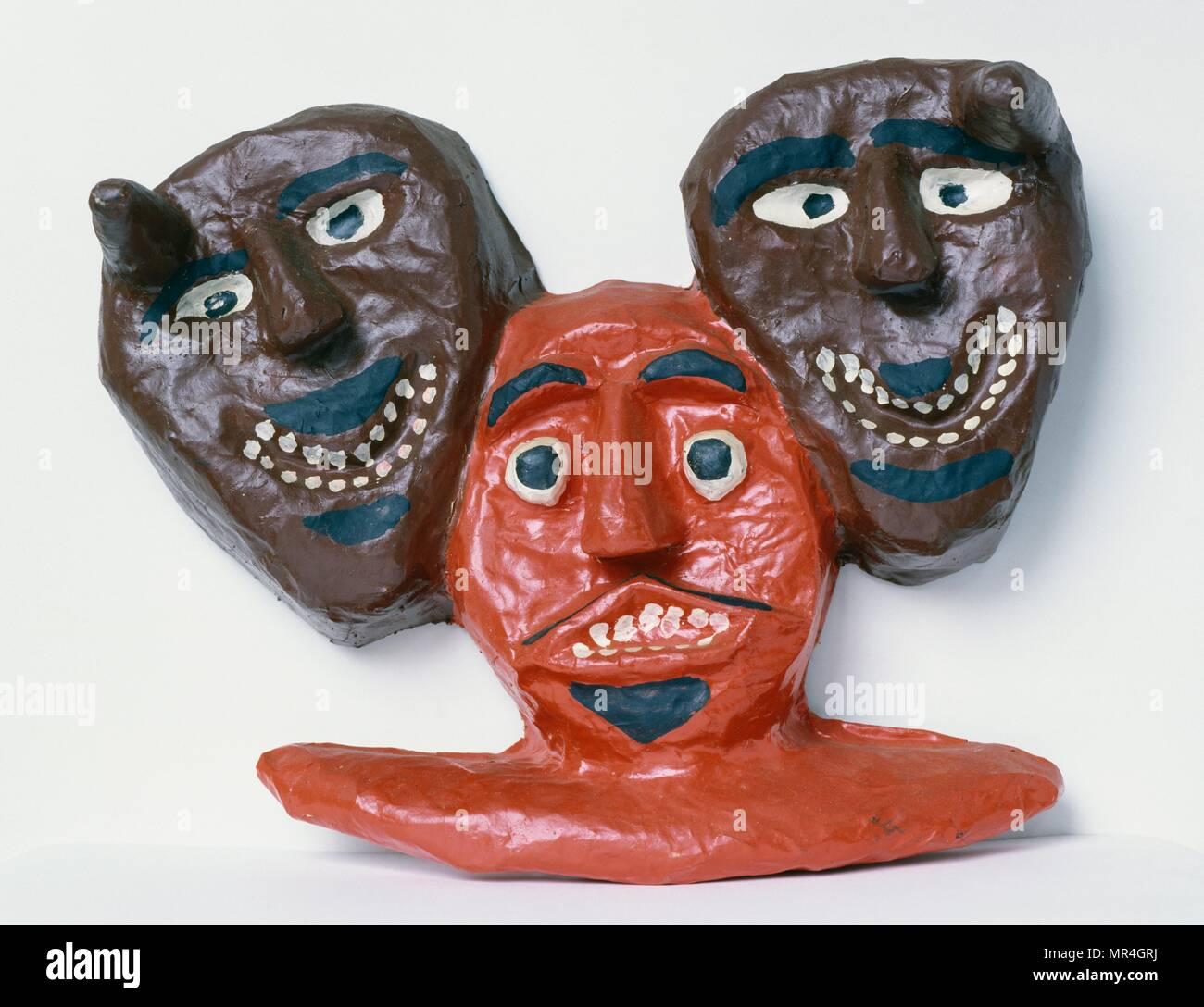 Haitian folk art: papier mache death masks 1995 - Stock Image