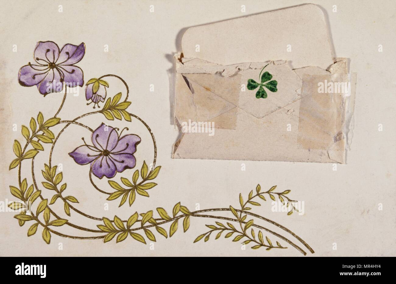 Vintage French postcard illustrated with mauve flowers and a four leaf clover roses. 1900 - Stock Image