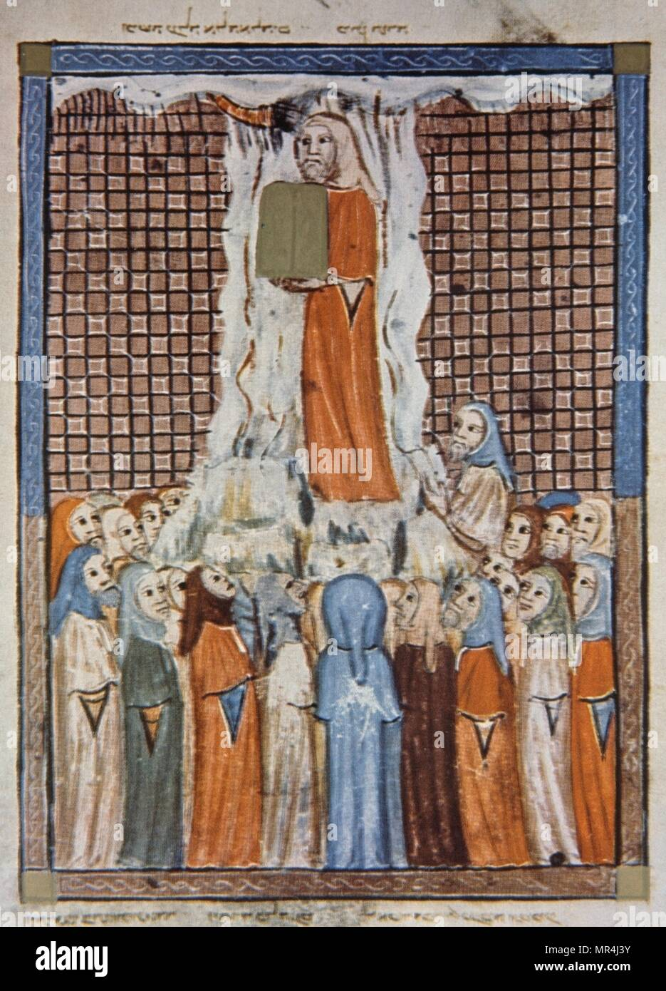 Moses presents the Ten Commandments to the Jews. Illustration from the Sarajevo Haggadah. A 14th century Jewish manuscript illustration and a Catalonian masterpiece, created in Barcelona, circa 1350, for a prominent Jewish family. - Stock Image