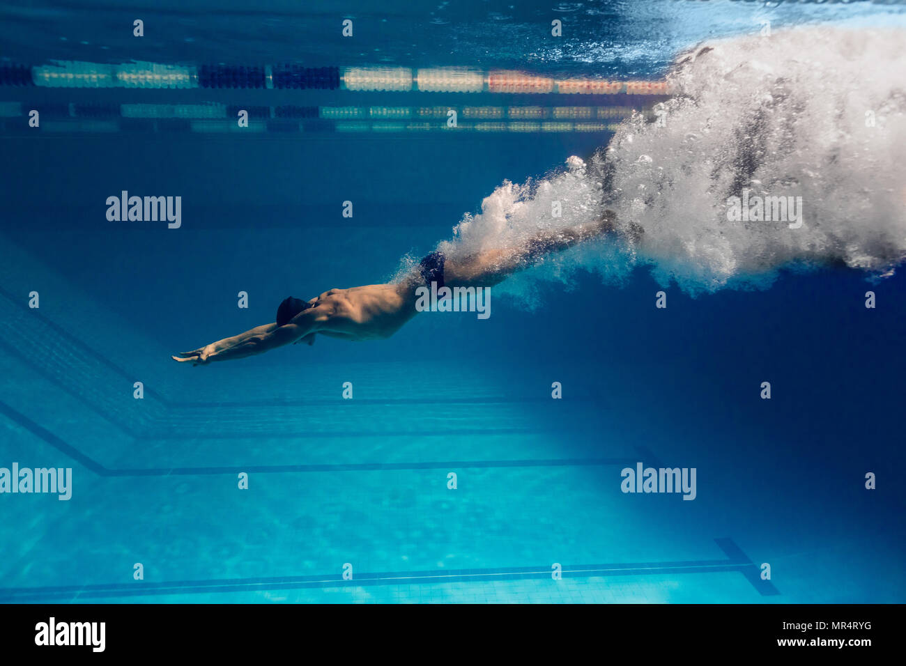 underwater picture of male swimmer swimming i swimming pool - Stock Image