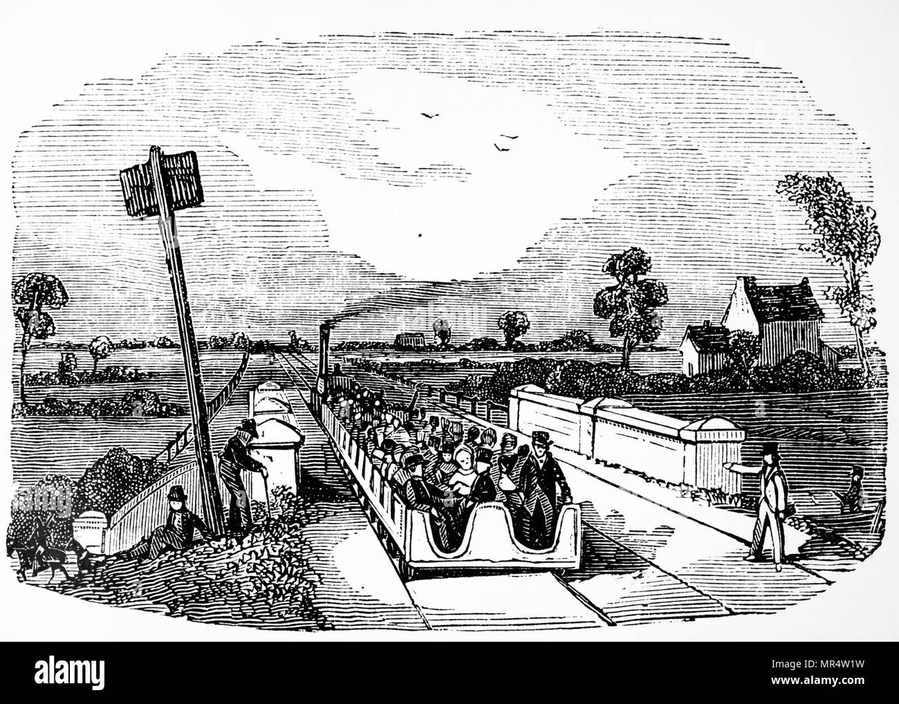 Engraving depicting open carriages running on a broad gauge track. Dated 19th century - Stock Image