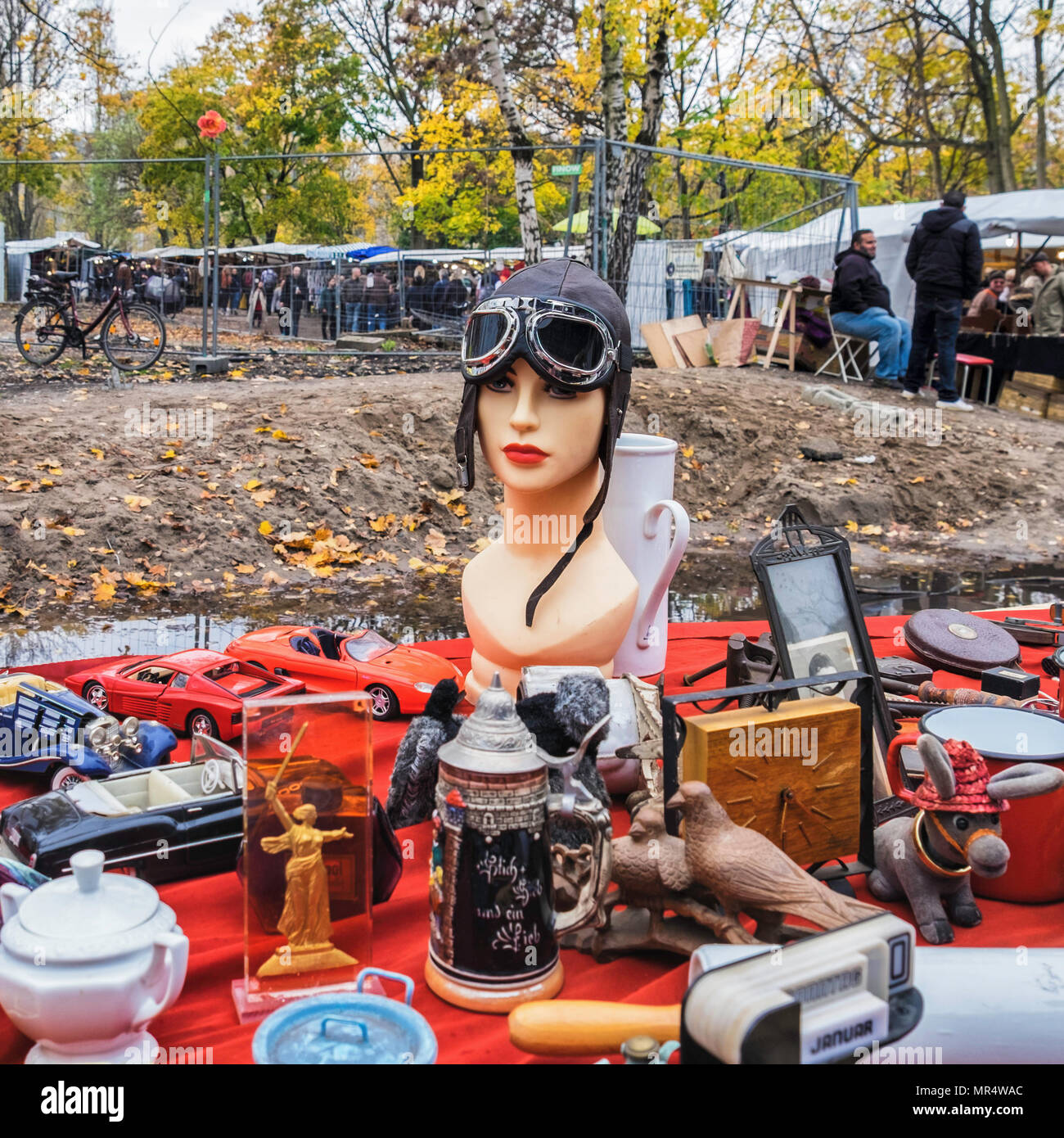 Berlin Prenzlauer Berg.Mauerpark Fleamarket.Rains & poor drainage of market area cause problems for stall holders,Stall with mannequin head & goggles - Stock Image