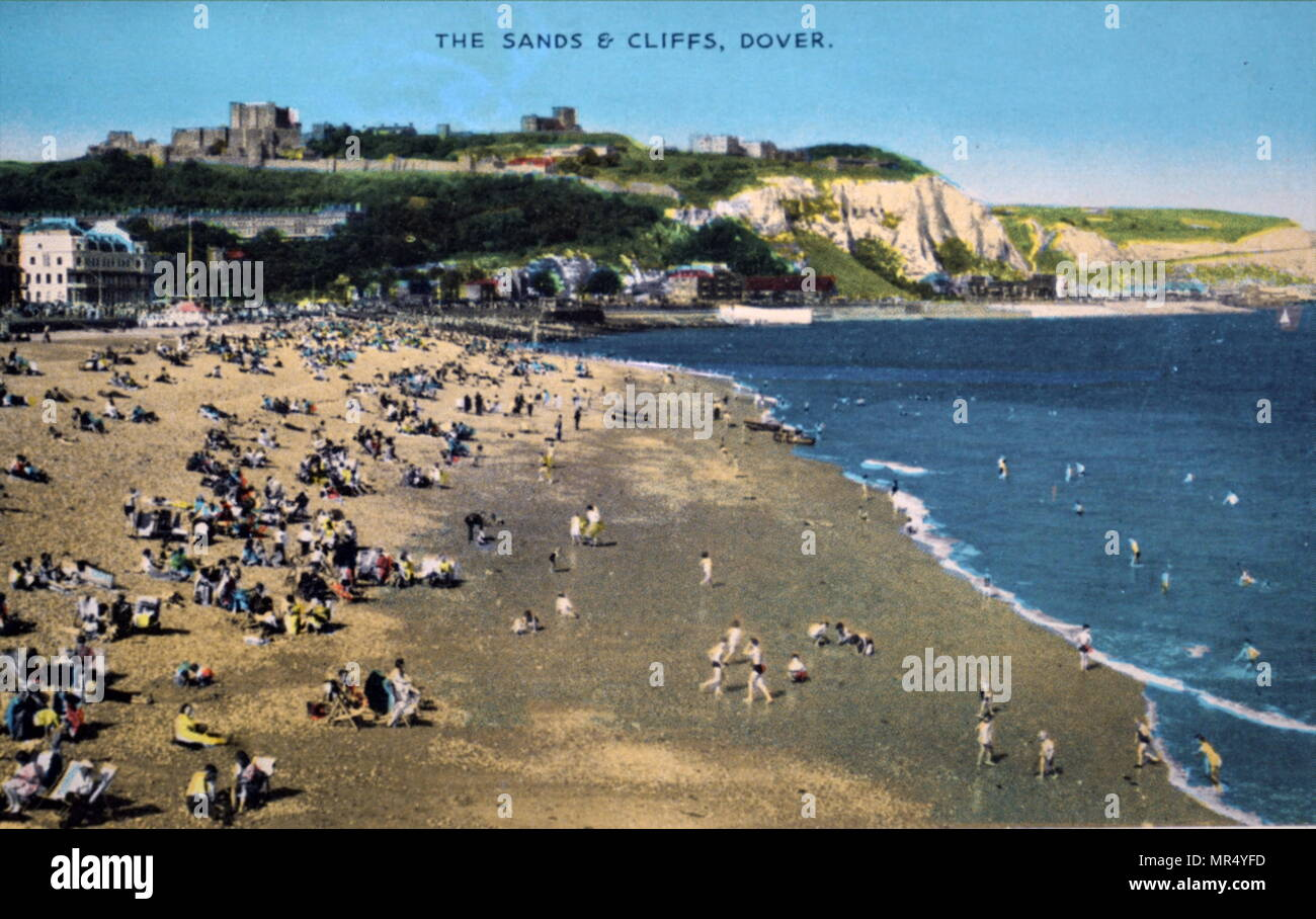 Hand-coloured photograph of holidaymakers enjoying themselves on Dover beach, Kent. Dated 20th century - Stock Image
