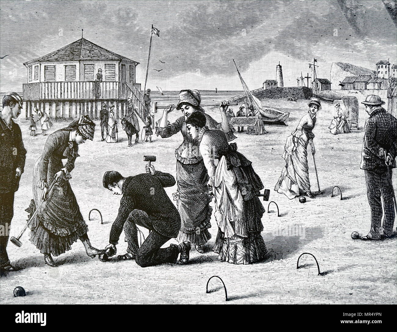 Illustration depicting a game of croquet being played on the beach. Dated 19th century - Stock Image