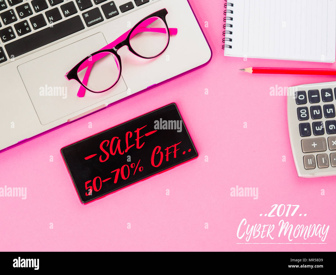 Cyber Monday Words With Mobile Phone And Office Accessories On Pink  Background.