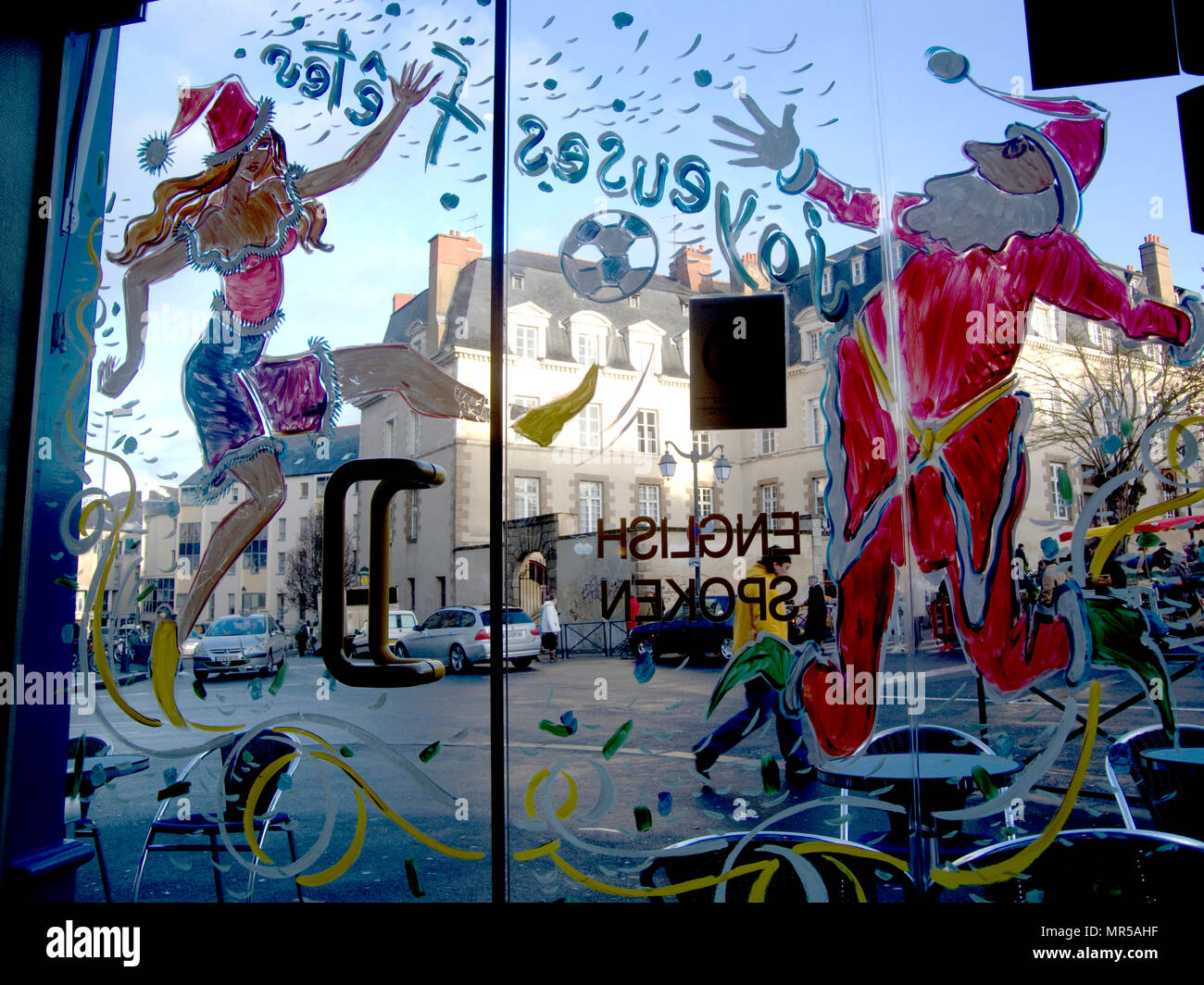 Rennes, FRANCE,  'General View, GV,  Christmas painted decorations on the cafe door and windows ',  Saturday Morning Market,  Brittany. location, Marché des Lices, Halles Centrales. Old Town Quarter  Saturday  26/12/2009      © Peter SPURRIER - Stock Image