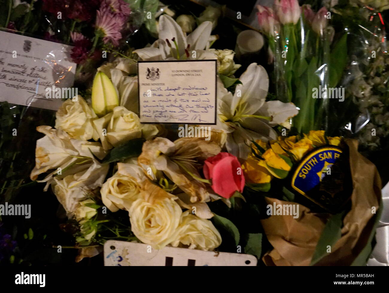 Photograph showing the tributes placed outside of Parliament in London, after the 22 March 2017, terrorist attack. The attacker, 52-year-old Briton Khalid Masood, drove a car into pedestrians on the pavement along the south side of Westminster Bridge and Bridge Street, injuring more than 50 people, four of them fatal. Dated 21st Century - Stock Image