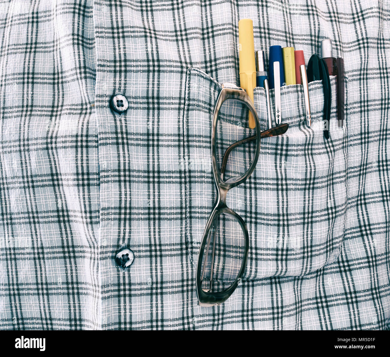 Pens and glasses in shirt pocket - Stock Image
