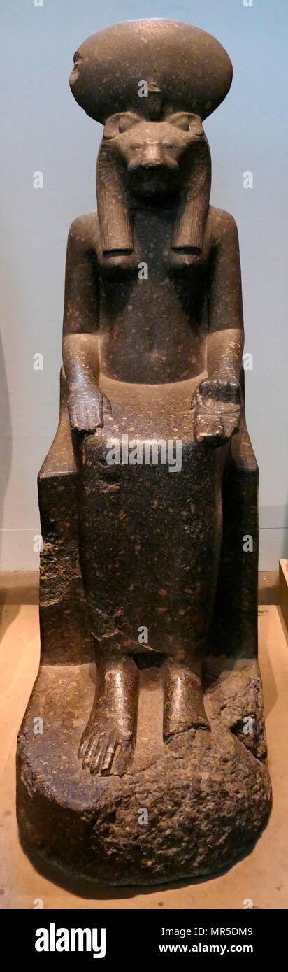 Black granite statue of the goddess Sakhmet, from the Temple of Mut, Thebes, Egypt. circa 1400 BC. In Egyptian mythology, Sekhmet was a warrior goddess as well as goddess of healing Stock Photo