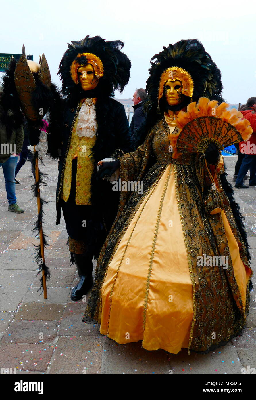 Costumed attendee at the Venice Carnival (Carnevale di Venezia), an annual festival held in Venice, Italy. Started to recall a victory of the 'Serenissima Repubblica' against the Patriarch of Aquileia, in the year 1162. In the honour of this victory, the people started to dance and gather in San Marco Square. Stock Photo