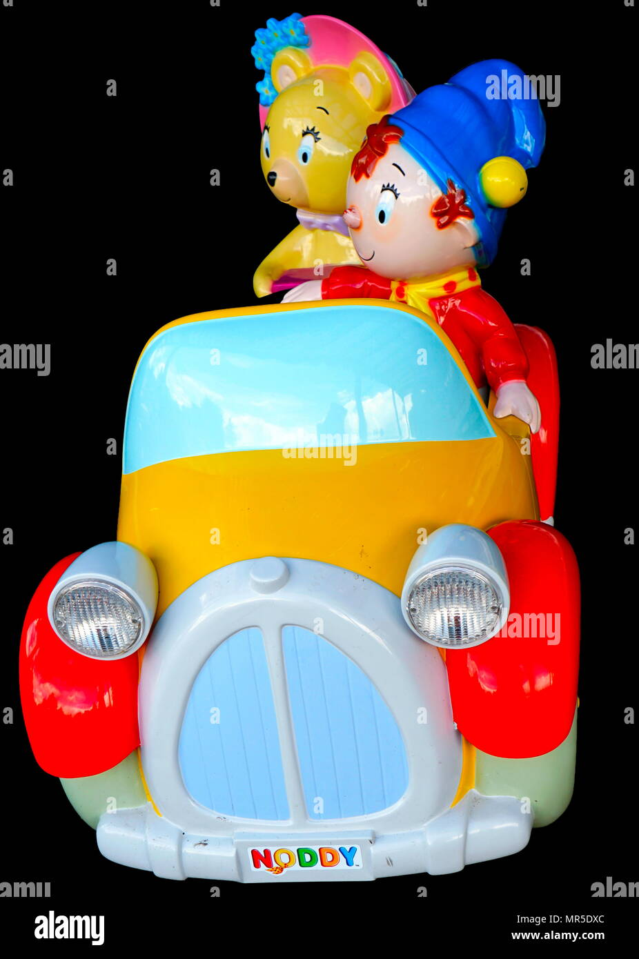 Photograph of a Noddy car. Noddy is a fictional character created by English children's author Enid Blyton, originally published between 1949 and 1963. Noddy was illustrated by the Dutch artist Eelco Martinus ten Harmsen van der Beek from 1949 until 1953. Television shows based on the character have run on British television since 1955 and continue to appear to this day - Stock Image