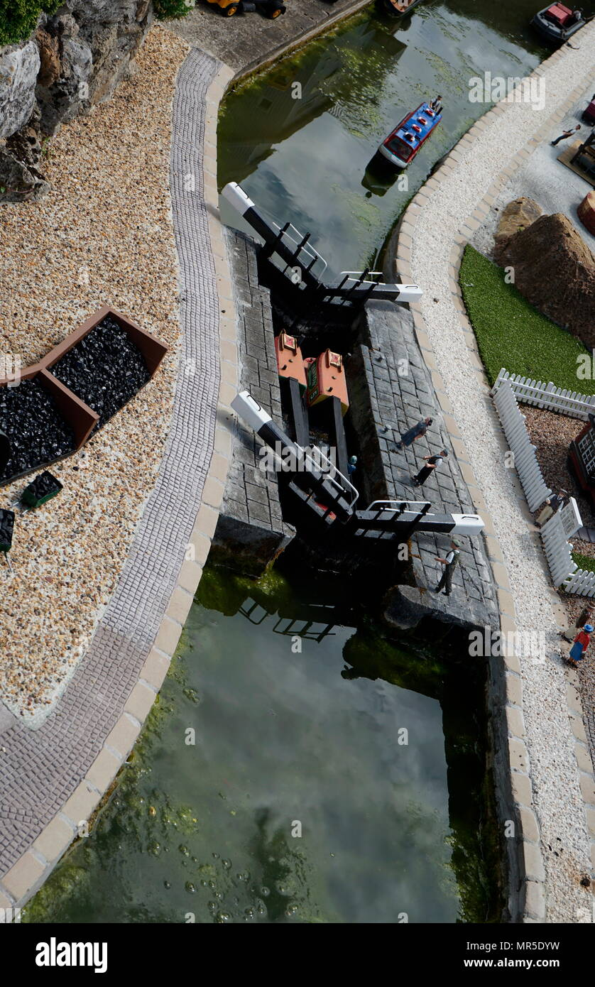 Canal life with canal boat, in the model village at Bekonscot, Buckinghamshire, England, the oldest  model village in the world. Stock Photo