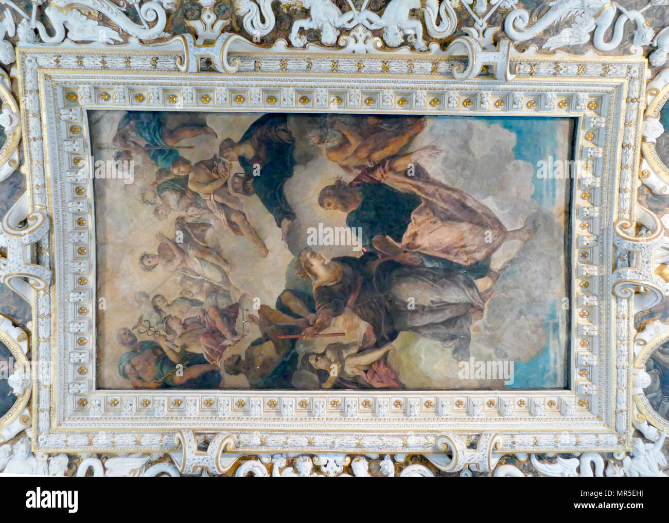 ornate plasterwork and painting adorn ceilings within the state rooms of the Doge's Palace in Venice Italy - Stock Image