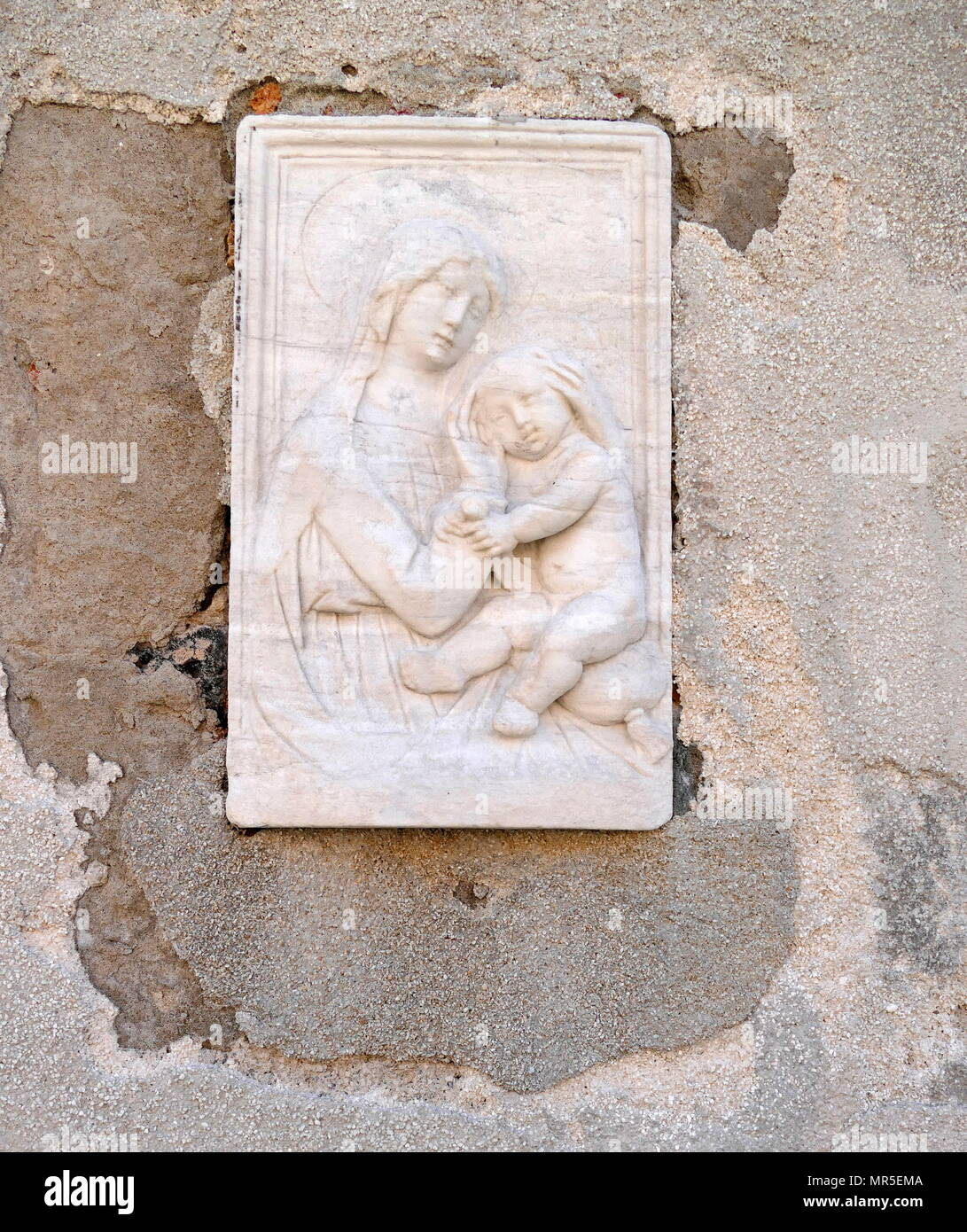 Street shrine depicting The virgin Mary with Christ. Venice, Arsenale district, Italy - Stock Image