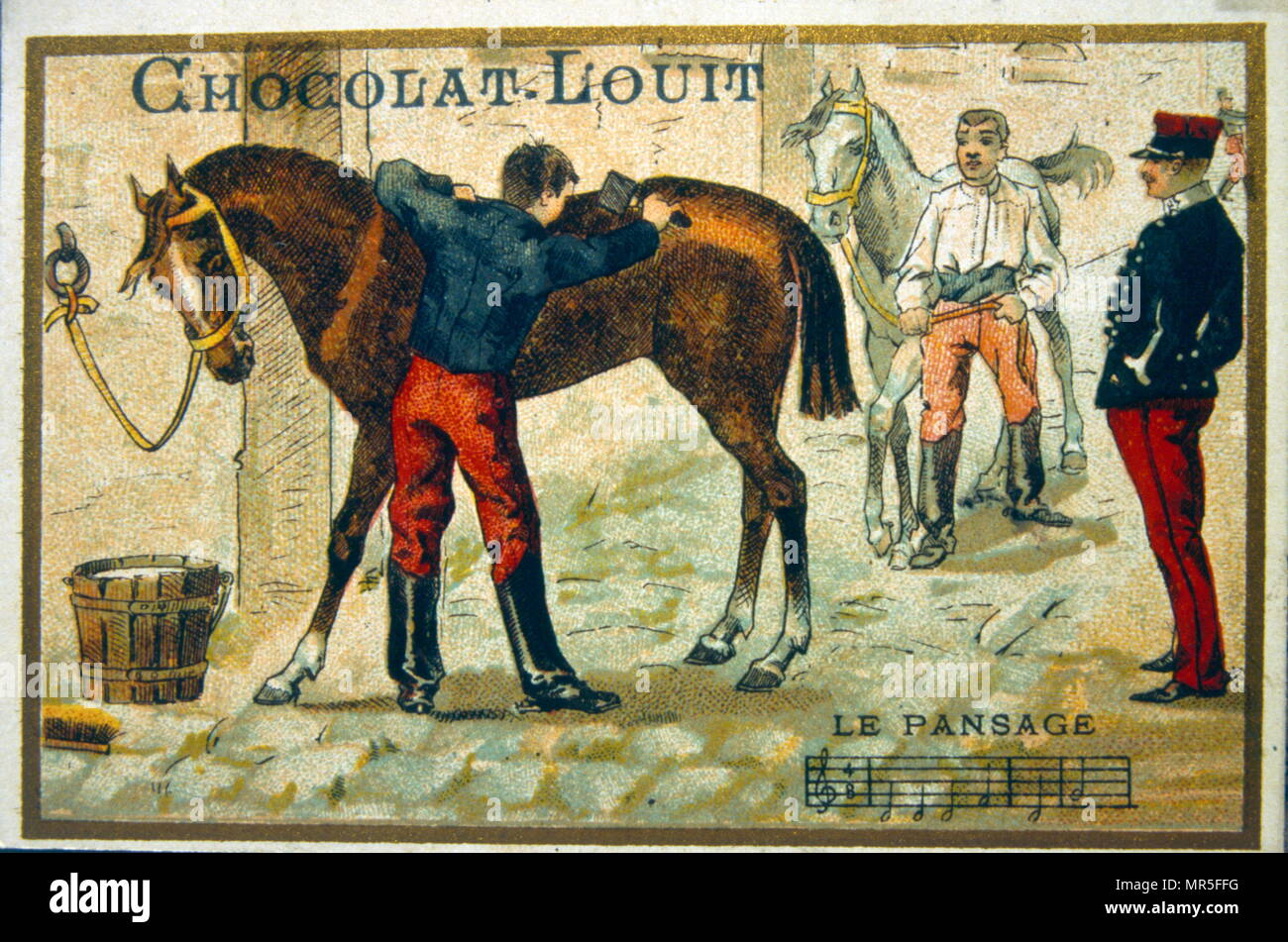 Chromolithograph from a chocolate wrapper, circa 1900, depicting French cavalry grooms attending horses in stables - Stock Image