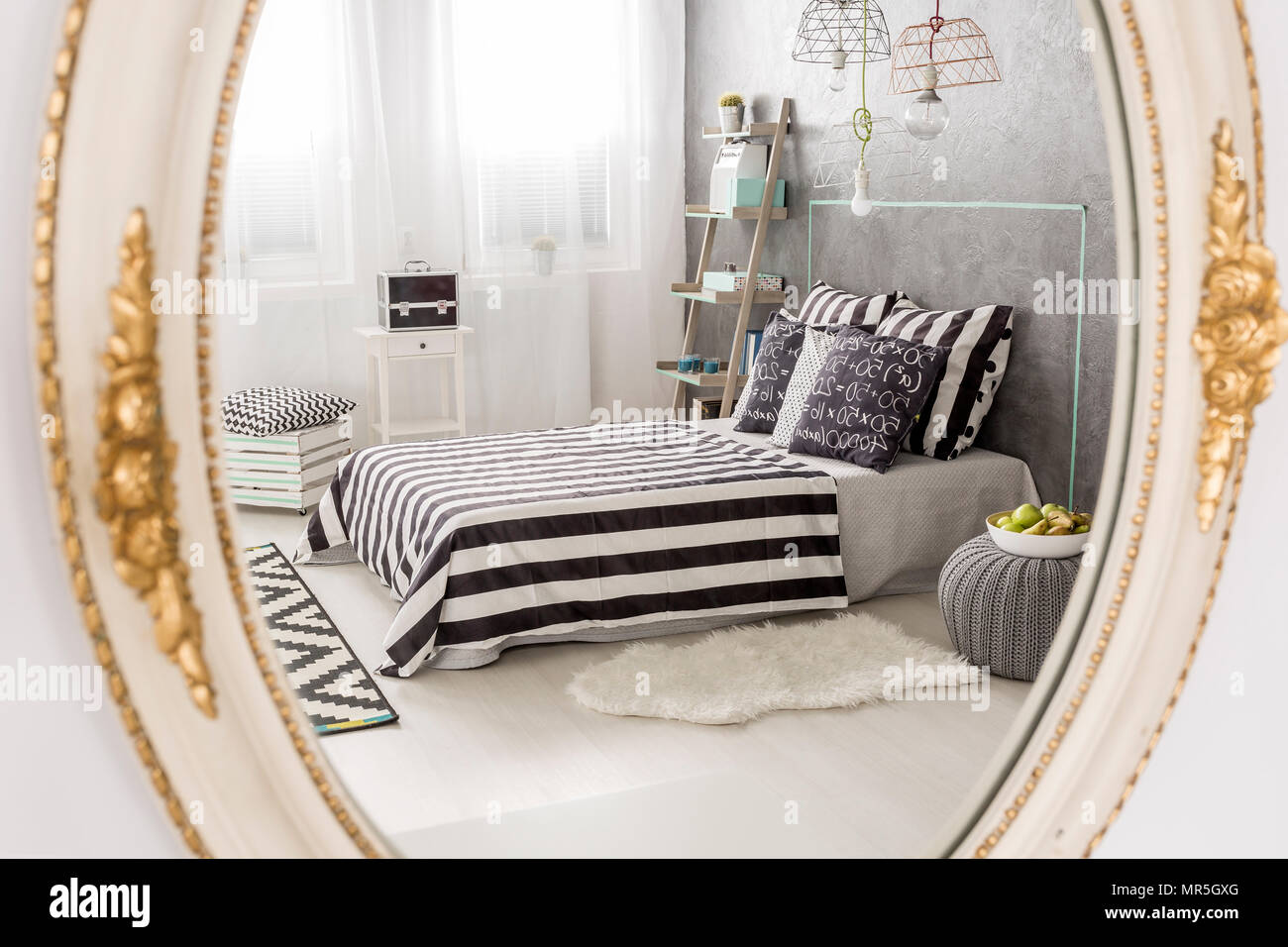 Mirror Reflection Of A Contemporary Bedroom Round Mirror With White Stylish Frame Stock Photo Alamy
